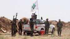 Iraqi security forces and Shiite militiamen