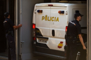 Police close the garage doors as a police van, believed to be carrying Ashya King's parents, arrives at the National Court in Madrid, Spain on Monday, Sept. 1, 2014. A critically-ill 5-year-old boy driven to Spain by his parents against doctors' advice is receiving medical treatment for a brain tumor in a Spanish hospital as his parents await extradition to Britain. (AP / Andres Kudacki)