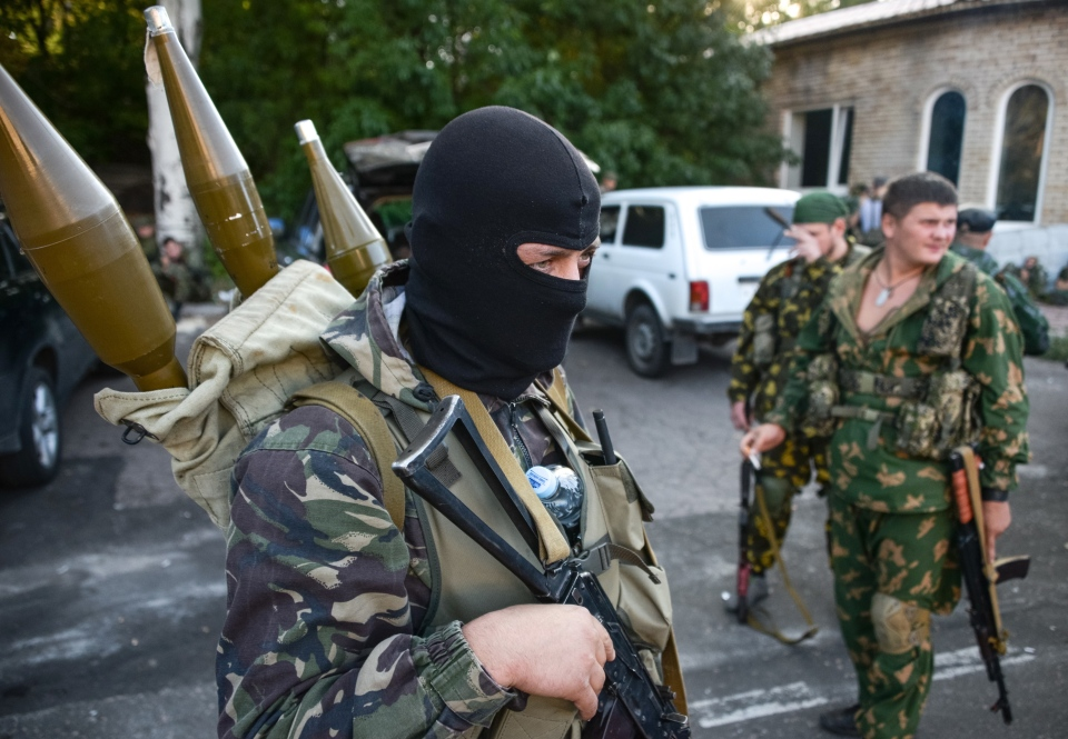 Pro-Russian rebels prepare arms for the the assault on the positions of Ukrainian army in Donetsk airport, eastern Ukraine on Sunday, Aug. 31, 2014. (AP / Mstislav Chernov)