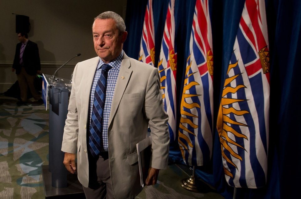 B.C. Education Minister Peter Fassbender leaves after speaking about the teachers' strike and confirming classes at public school will not begin Tuesday, during a news conference in Vancouver, on Sunday, Aug. 31, 2014. (Darryl Dyck / THE CANADIAN PRESS)