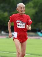 103-year-old Japanese sprinter Hidekichi Miyazaki runs during the men's 100m dash at a Japan Masters Athletics competition in Kyoto on August 3, 2014. ©AFP PHOTO/Toru YAMANAKA