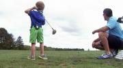 Little boy a golfing inspiration