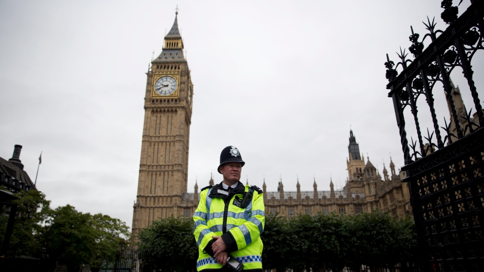 A British police officer stands guard outside the Houses of Parliament in London on  Monday, Sept. 1, 2014. (AP / Matt Dunham)