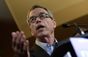 Finance Minister Joe Oliver speaks to media prior to holding a Summer Policy Retreat in Wakefield, Que., on Tuesday, Aug. 12, 2014. (Sean Kilpatrick / THE CANADIAN PRESS)
