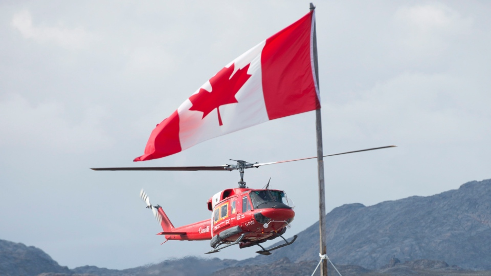 A Canadian Coast Guard helicopter makes an approach to land at the military camp on Baffin Island, Tuesday, Aug. 26, 2014. (Adrian Wyld / THE CANADIAN PRESS)