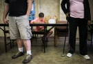 George Sentilles, 12, looks at a math problem as he does his homework at a church in Memphis, Tenn., on Thursday, Aug. 7, 2014. (The Commercial Appeal / Yalonda M. James)