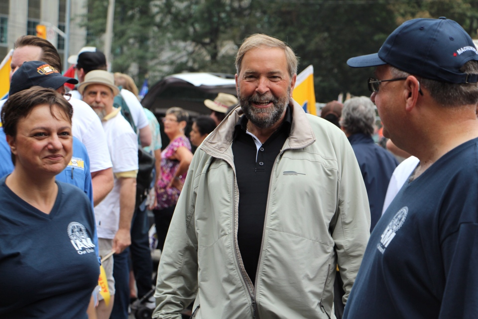 Federal NDP Leader Tom Mulcair greets participants at the annual Labour Day parade in Toronto on Monday, Sept.1, 2014. (Adam Miller / THE CANADIAN PRESS)