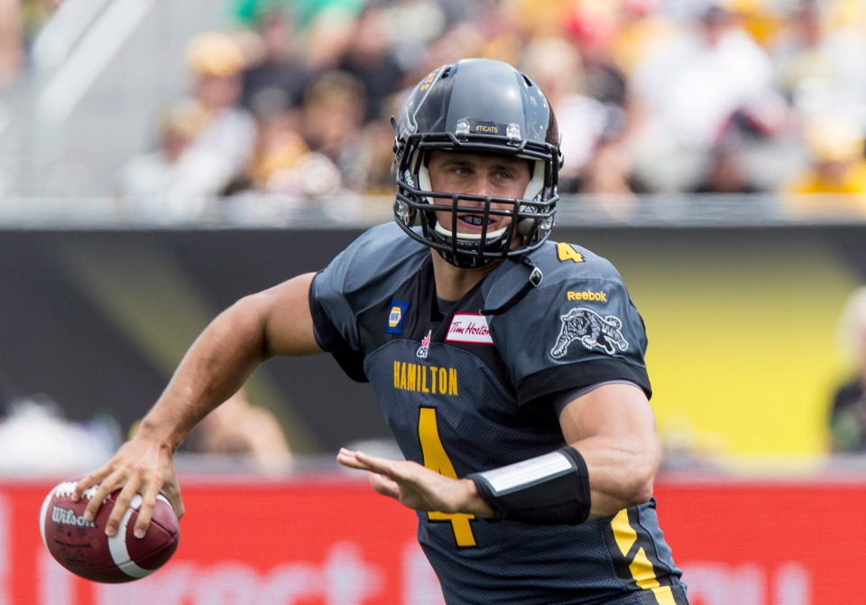 Hamilton Tiger-Cats quarterback Zach Collaros looks to pass against the Toronto Argonauts during the first half of the annual CFL Labour Day Classic and inaugural game at the brand new Tim Hortons Field in Hamilton, Ont., Monday, September 1, 2014. Collaros will miss the remainder of the CFL season with a knee injury. (THE CANADIAN PRESS/Aaron Lynett)