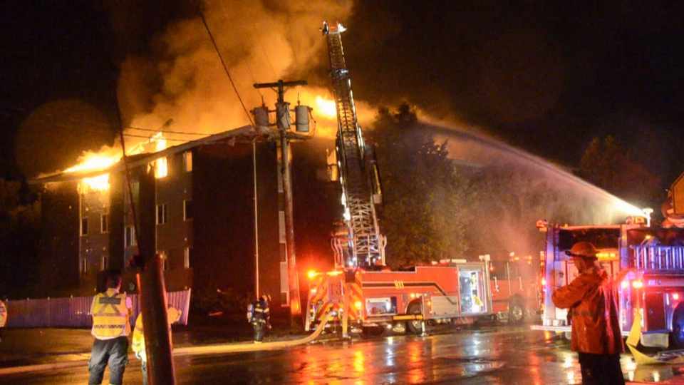 Fire crews battle an apartment building blaze in D