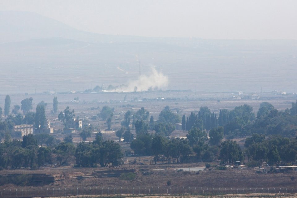 Smoke caused by fighting in Syria is seen from the Israeli-controlled Golan Heights, close to the border with Syria, Monday, Sept. 1, 2014. (AP / Sebastian Scheiner)