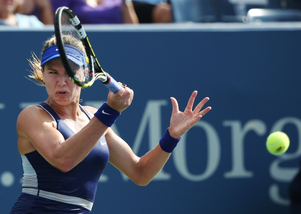 Eugenie Bouchard, of Canada, returns a shot to Ekaterina Makarova, of Russia, during the fourth round of the 2014 U.S. Open tennis tournament, Monday, Sept. 1, 2014, in New York. (AP / John Minchillo)