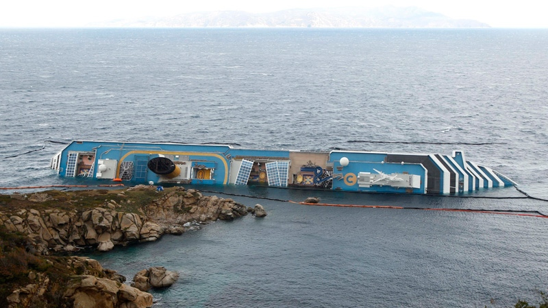 A view of the grounded cruise ship Costa Concordia off the Tuscan island of Giglio, Italy, Wednesday, Feb. 1, 2012. (AP Photo/Pier Paolo Cito)