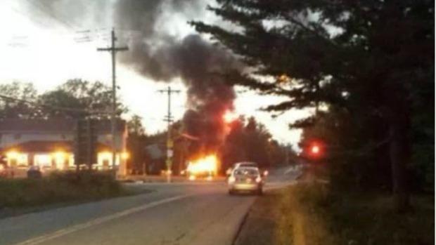 car on fire near Lake Echo