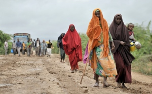 In this photo taken Sunday, Aug. 31, 2014 and provided by the African Union Mission to Somalia (AMISOM) Monday, Sept. 1, 2014, civilians who had left the town of Bulomarer when it was held by al Shabab militants, return following the town's capture by African Union (AU) and Somali government soldiers, in the Lower Shabelle region of Somalia. (AP / AMISOM, Tobin Jones)