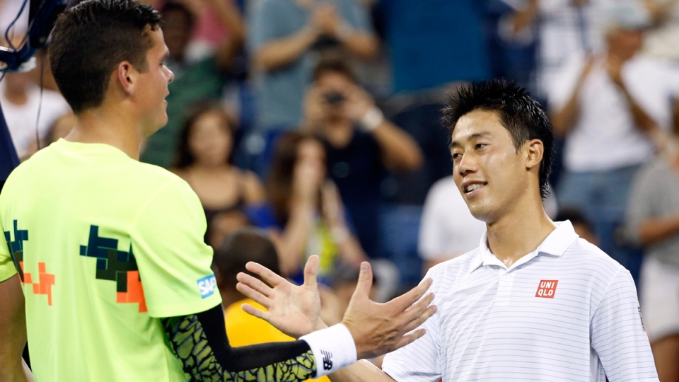 Kei Nishikori, right, shakes hands with Milos Raonic at the net in the early morning hours of in New York, Tuesday, Sept. 2, 2014. (AP / Jason DeCrow)