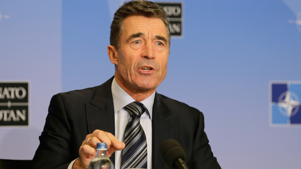 NATO Secretary General Anders Fogh Rasmussen addresses the media ahead of the NATO summit in Wales, at the Residence Palace in Brussels, Monday Sept. 1, 2014. (AP / Yves Logghe)