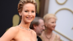 Jennifer Lawrence arrives at the Oscars on Sunday, March 2, 2014. Lawrence, a three-time Oscar nominee who won for her role in 'Silver Linings Playbook,' contacted the FBI after the images began appearing Sunday. (Jordan Strauss / Invision)