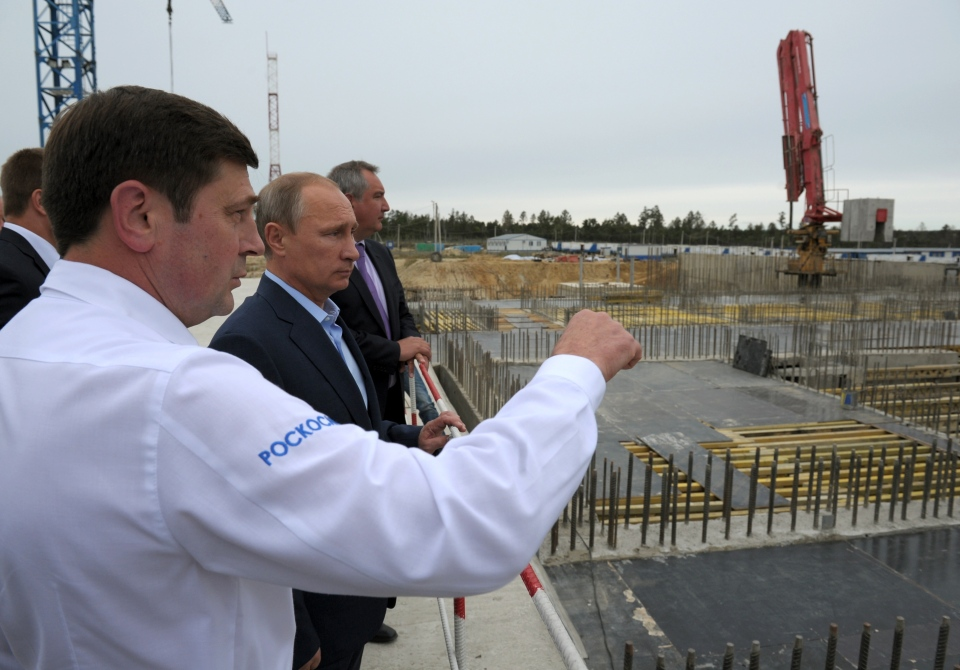 Russian President Vladimir Putin, second left, and Vice Premier Dmitry Rogozin listen to Russian Space Agency chief Oleg Ostapenko, left, during a visit to a construction site of the Vostochny ( Eastern) Cosmodrome in the Amur region, Tuesday, Sept. 2, 2014. (RIA Novosti / Alexei Druzhinin / Presidential Press Service)