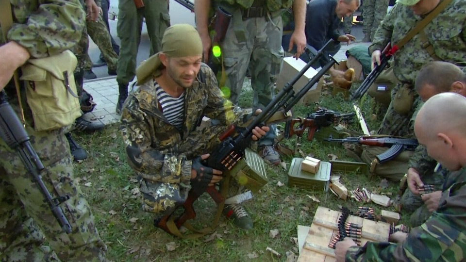 Pro-Russian rebels prepare ammunition in the streets of Donetsk, Ukraine.