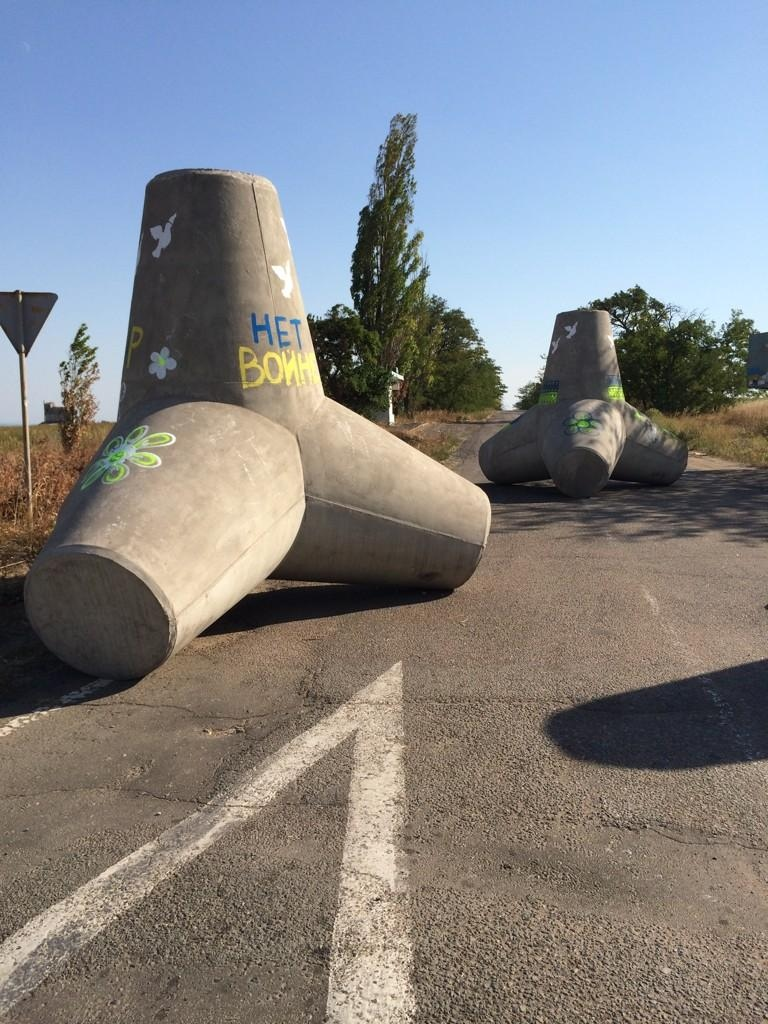Barriers with 'No War' painted on them are seen on a road outside Mariupol, Ukraine, Tuesday, Sept. 2, 2014. (Ben O'Hara-Byrne / CTV News)