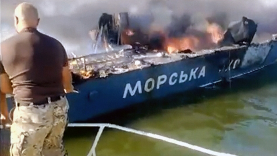 A Ukrainian naval vessel up in flames following an attack in the Azov Sea, Monday, Sept. 1, 2014.