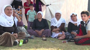 Displaced Iraqis who have fled scenes of fierce fighting in the north of the country are seen in this image made from video. (United Nations High Commissioner for Refugees / YouTube)