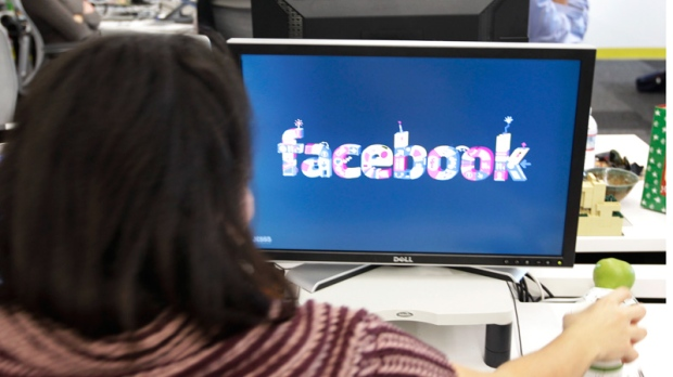 Workers are shown inside Facebook headquarters in Menlo Park, Calif. on Tuesday, Dec. 13, 2011. (AP / Paul Sakuma)