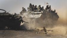 Pro-Russian rebels pass Ukrainian vehicles
