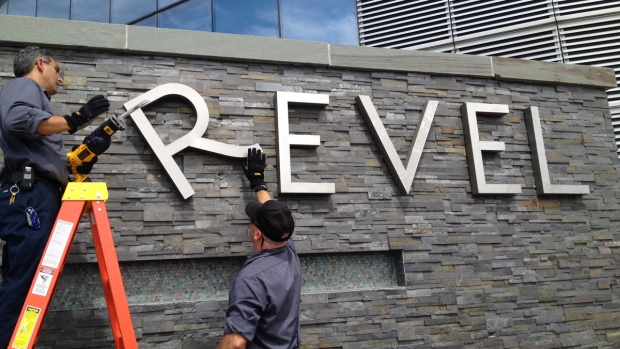 Removing a sign at Revel hotel-casino