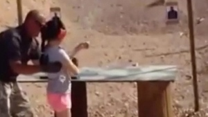 Mohave County Sheriff's Office image from video of a nine-year-old girl being taught to fire an Uzi submachine gun in Arizona. (REX / AP)
