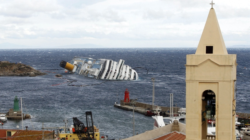 The grounded cruise ship Costa Concordia lies on its side off the Tuscan island of Giglio, Italy, Wednesday, Feb. 1, 2012. (AP Photo/Pier Paolo Cito)