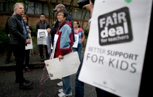 British Columbia Teacher Federation (BCTF) President Jim Iker is seen outside the Britannia Secondary and Elementary Schools in Vancouver, Tuesday, Sept. 2, 2014. (Jonathan Hayward / THE CANADIAN PRESS)
