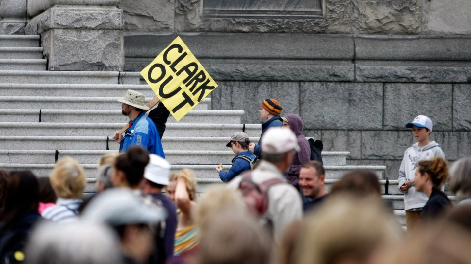 """Parents, teachers, and politicians rally for B.C. education dubbed """"Christy's Class"""" during a teach-in on the B.C. Legislature lawn in Victoria, B.C., September 2, 2014 during what should be the first day of classes across the province. (Chad Hipolito / THE CANADIAN PRESS)"""