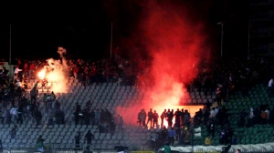 Egyptian fans rush into the field following Al-Ahly club soccer match against Al-Masry club at the soccer stadium in Port Said, Egypt Wednesday, Feb. 1, 2012. (AP Photo)