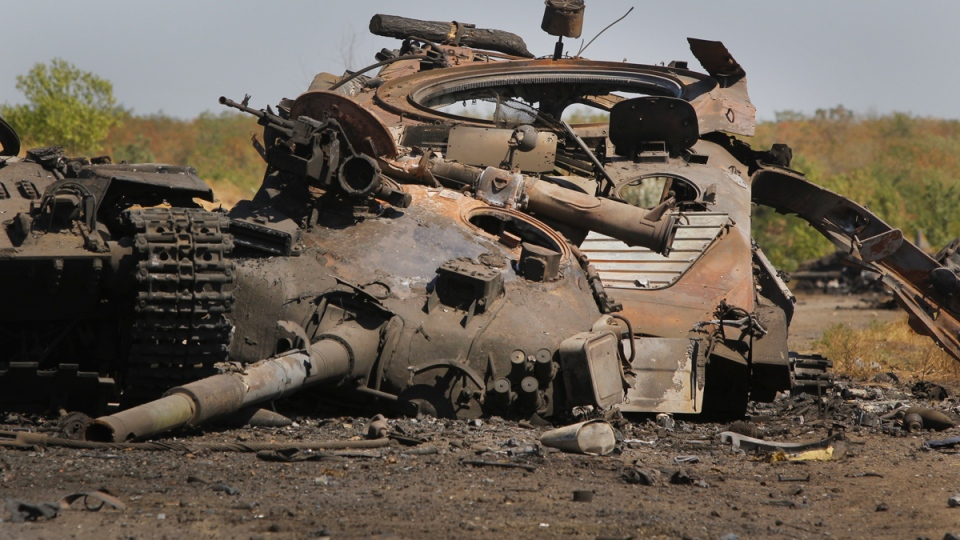 Part of a column of destroyed Ukrainian military vehicles are strewn near the village of Novokaterynivka, eastern Ukraine, Tuesday, Sept. 2, 2014. (AP / Sergei Grits)
