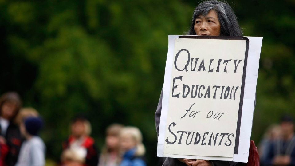 Parents, teachers and politicians rally for B.C. education dubbed 'Christy's Class' during a teach-in on the B.C. Legislature lawn in Victoria, B.C., September 2, 2014 during what should be the first day of classes across the province. (Chad Hipolito / THE CANADIAN PRESS)