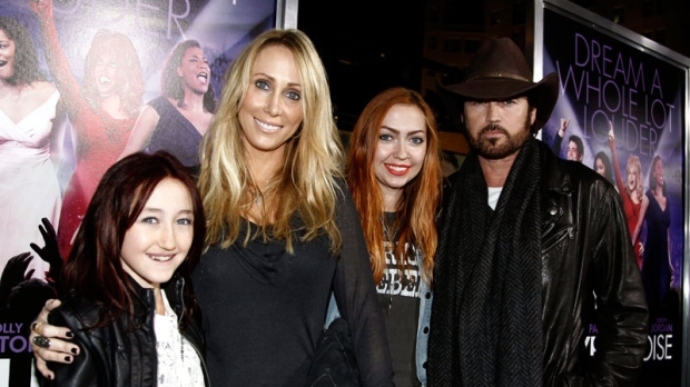From left, Noah Cyrus, Tish Cyrus, Brandi Cyrus, and Billy Ray Cyrus arrive at the premiere of 'Joyful Noise' in Los Angeles, Monday, Jan. 9, 2012. (AP / Matt Sayles)