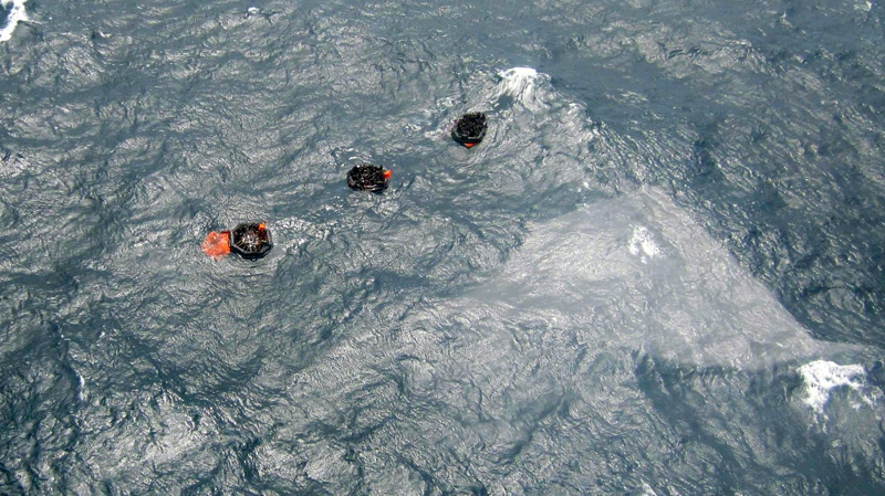 Three life rafts from the MV Rabaul Queen are seen floating above the sunken hull of a ferry in the open waters of Papua New Guinea Thursday, Feb. 2, 2012. (Post Courier)