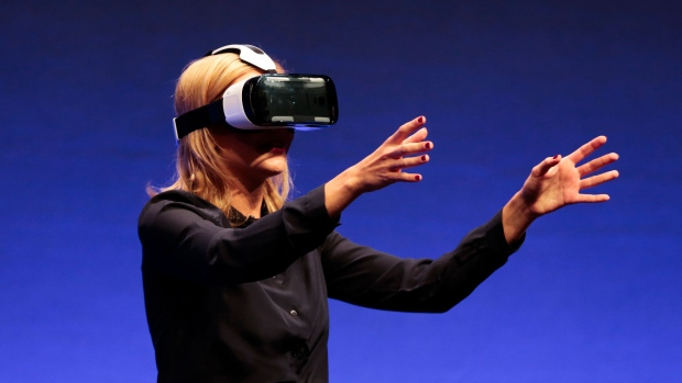 Hundreds gathered to check out gadgets on display ahead of one of the world&#39;s largest trade fairs for consumer electronics: the IFA in Berlin, Germany. The trade show kicks of September 5. <br><br> British television presenter Rachel Riley shows a virtual-reality headset called Gear VR during an unpacked event of Samsung ahead of the consumer electronic fair IFA in Berlin, Wednesday, Sept. 3, 2014. (AP / Markus Schreiber)