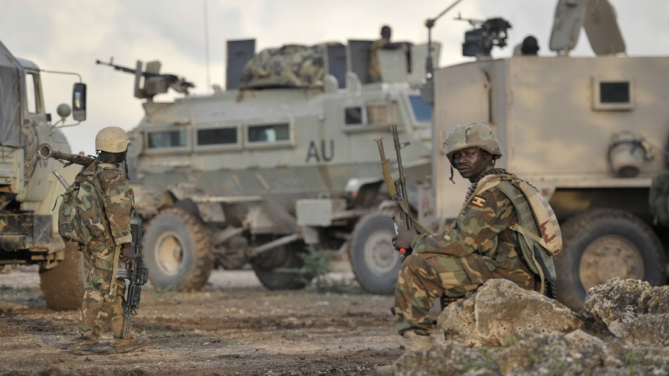 African Union (AU) soldiers from Uganda rest in the town of Kurtunwarey in Somalia, Sunday, Aug. 31, 2014. (AP / AMISOM, Tobin Jones)