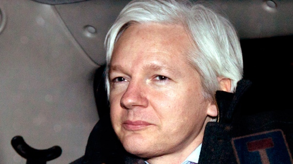 WikiLeaks founder Julian Assange is driven away in a taxi after leaving his hearing at the Supreme Court in London, Thursday, Feb. 2, 2012. (AP / Matt Dunham)
