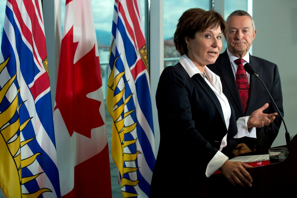 British Columbia Premier Christy Clark and Education Minister Peter Fassbender talk about the ongoing teachers' dispute at a news conference in Vancouver on Wednesday, Sept.3, 2014. (Jonathan Hayward / THE CANADIAN PRESS)