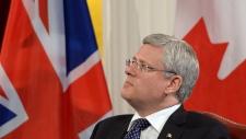Harper NATO spending Canada