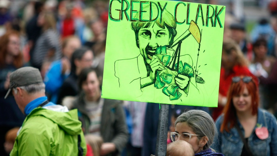 """Parents, teachers and politicians rally for B.C. education dubbed """"Christy's Class"""" during a teach-in on the B.C. Legislature lawn in Victoria, B.C., Sept. 2, 2014. (Chad Hipolito / THE CANADIAN PRESS)"""
