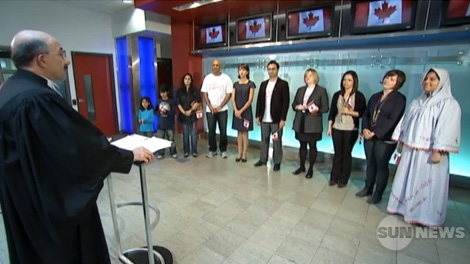 This image taken from video, shows a citizenship reaffirmation ceremony broadcast on the Sun News network in October 2011.