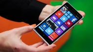 A woman shows the new Lumia 830 smart phone during a Microsoft Nokia presentation event in Berlin, Sept. 4, 2014. (AP / Markus Schreiber)