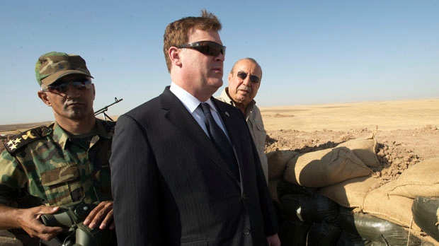 Canadian Foreign Affairs Minister John Baird, centre, and Iraqi Deputy Minister Rowsch Nouri Sharways look at the ISIS positions from a front line bunker Thursday, September 4, 2014 in Kalak, Iraq. THE CANADIAN PRESS/Ryan Remiorz