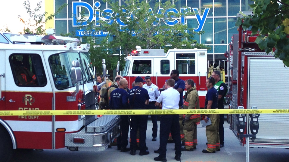 Firefighters confer outside the Nevada Discovery Museum in Reno, Nev., Wednesday Sept. 3, 2014. (AP / Scott Sonner).