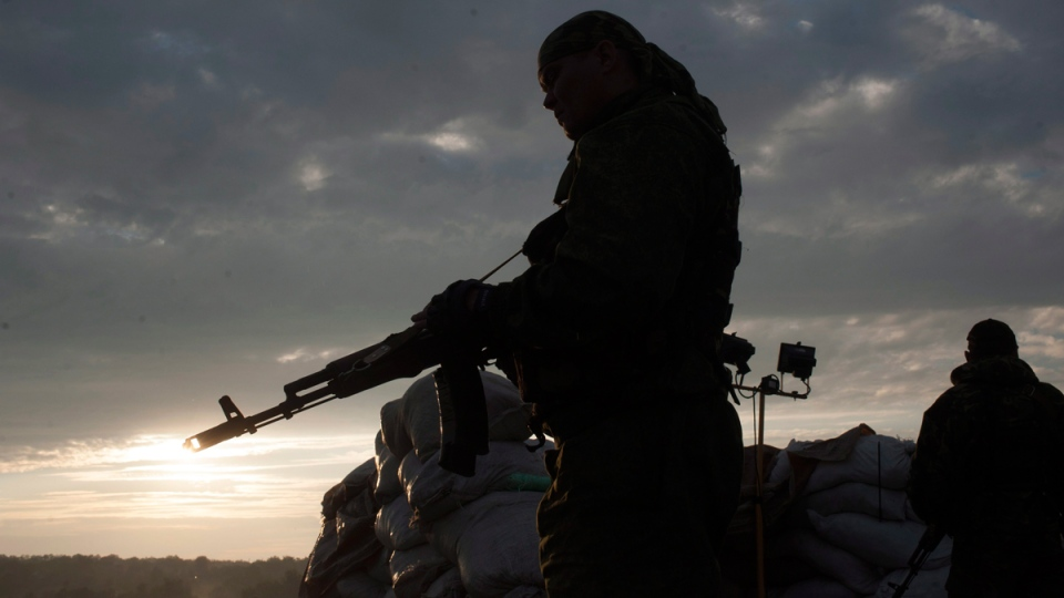 Pro-Russian fighters stand guard at a check point in the village of Karlivka near Donetsk, eastern Ukraine, on June 18, 2014. (AP / Evgeniy Maloletka)