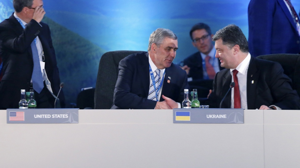 U.S. ambassador to NATO Douglas Lute, left, shakes hands with Ukraine President Petro Poroshenko during a NATO meeting on Ukraine at the NATO summit at Celtic Manor in Newport, Wales, Thursday, Sept. 4, 2014. (AP / Charles Dharapak)